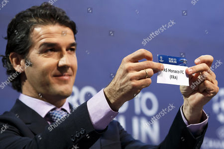 Former German Soccer Player Karl-heinz Riedle Ambassador For the Uefa Champions League Final in Berlin Shows the Ticket of As Monaco During the Draw of the Uefa Champions League 2014-15 Quarter Final Matches at the Uefa Headquarters in Nyon Switzerland 20 March 2015 Switzerland Schweiz Suisse Nyon