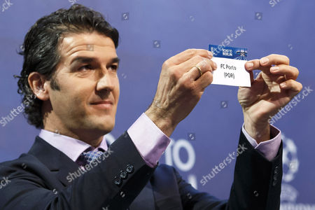 Former German Soccer Player Karl-heinz Riedle Ambassador For the Uefa Champions League Final in Berlin Shows the Ticket of Fc Porto During the Draw of the Uefa Champions League 2014-15 Quarter Final Matches at the Uefa Headquarters in Nyon Switzerland 20 March 2015 Switzerland Schweiz Suisse Nyon