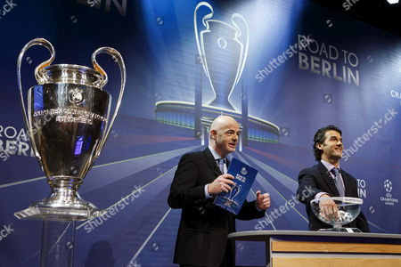 Former German Soccer Player Karl-heinz Riedle (r) Ambassador For the Uefa Champions League Final in Berlin and Uefa General Secretary Gianni Infantino (l) Conduct the Draw of the Uefa Champions League 2014-15 Quarter Final Matches at the Uefa Headquarters in Nyon Switzerland 20 March 2015 Switzerland Schweiz Suisse Nyon