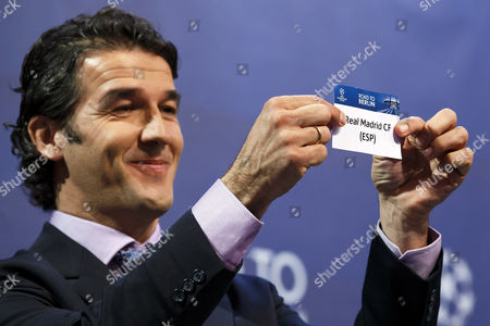 Former German Soccer Player Karl-heinz Riedle Ambassador For the Uefa Champions League Final in Berlin Shows the Ticket of Real Madrid Cf During the Draw of the Uefa Champions League 2014-15 Quarter Final Matches at the Uefa Headquarters in Nyon Switzerland 20 March 2015 Switzerland Schweiz Suisse Nyon