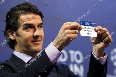 Former German Soccer Player Karl-heinz Riedle Ambassador For the Uefa Champions League Final in Berlin Shows the Ticket of Atletico Madrid During the Draw of the Uefa Champions League 2014-15 Quarter Final Matches at the Uefa Headquarters in Nyon Switzerland 20 March 2015 Switzerland Schweiz Suisse Nyon