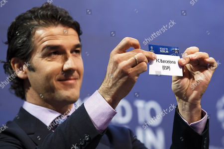 Former German Soccer Player Karl-heinz Riedle Ambassador For the Uefa Champions League Final in Berlin Shows the Ticket of Fc Barcelona During the Draw of the Uefa Champions League 2014-15 Quarter Final Matches at the Uefa Headquarters in Nyon Switzerland 20 March 2015 Switzerland Schweiz Suisse Nyon