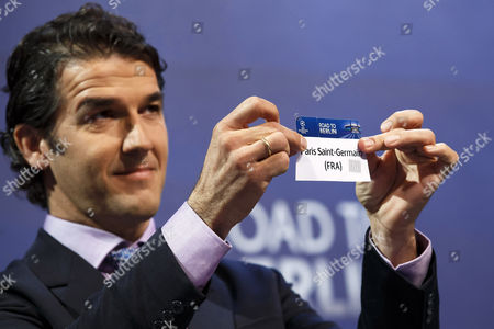 Former German Soccer Player Karl-heinz Riedle Ambassador For the Uefa Champions League Final in Berlin Shows the Ticket of Paris Saint-germain During the Draw of the Uefa Champions League 2014-15 Quarter Final Matches at the Uefa Headquarters in Nyon Switzerland 20 March 2015 Switzerland Schweiz Suisse Nyon
