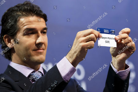 Former German Soccer Player Karl-heinz Riedle Ambassador For the Uefa Champions League Final in Berlin Shows the Ticket of Bayern Munich During the Draw of the Uefa Champions League 2014-15 Quarter Final Matches at the Uefa Headquarters in Nyon Switzerland 20 March 2015 Switzerland Schweiz Suisse Nyon