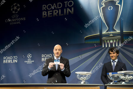 Uefa General Secretary Gianni Infantino (l) and Former German Soccer Player Karl-heinz Riedle Ambassador For the Uefa Champions League Final in Berlin Right Draws Italy's Soccer Team Juventus Football Club During the Draw of the Round of 16 of the Uefa Champions League 2014/15 at the Uefa Headquarters in Nyon Switzerland 15 December 2014 Switzerland Schweiz Suisse Nyon