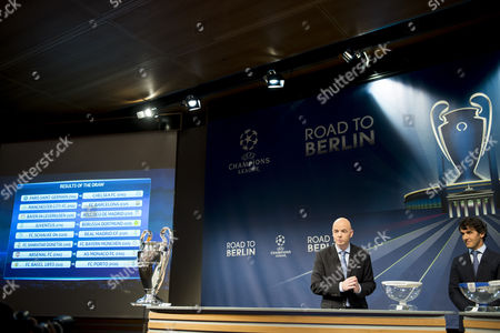 Uefa General Secretary Gianni Infantino (l) and Former German Soccer Player Karl-heinz Riedle Ambassador For the Uefa Champions League Final in Berlin During the Draw of the Round of 16 of the Uefa Champions League 2014/15 at the Uefa Headquarters in Nyon Switzerland 15 December 2014 Switzerland Schweiz Suisse Nyon