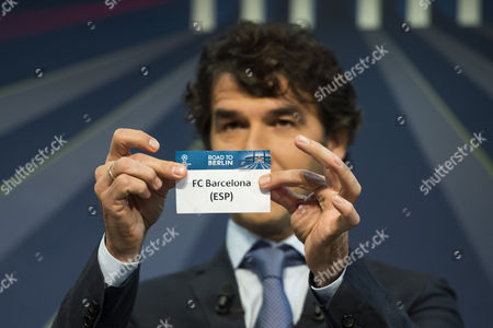 Former German Soccer Player Karl-heinz Riedle Ambassador For the Uefa Champions League Final in Berlin Draws Spain's Soccer Team Fc Barcelona During the Draw of the Round of 16 of the Uefa Champions League 2014/15 at the Uefa Headquarters in Nyon Switzerland 15 December 2014 Switzerland Schweiz Suisse Nyon