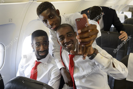 Stock Image of (l-r) Swiss National Soccer Players Johann Djourou Francois Moubandje and Gelson Fernandes Take a Selfie in a Aircraft at the Zurich Airport in Kloten Switzerlande 08 October 2014 the Swiss Team Faces Slovenia in an Uefa Euro 2016 Qualification Match in Maribor on 09 October 2014 Switzerland Schweiz Suisse Zurich
