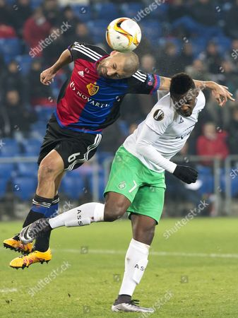 Basel's Walter Samuel Left Fights For the Ball Against Saint-etienne's Jean-christophe Bahebeck Right During the Uefa Europa League Round of 32 Second Leg Soccer Match Between Fc Basel 1893 and As Saint-etienne at the St Jakob-park Stadium in Basel Switzerland 25 February 2016 Switzerland Schweiz Suisse Basel