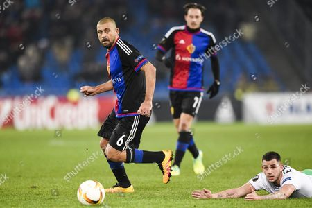 Basel's Walter Samuel (l) Fights For the Ball Against Saint-etienne's Valentin Eysseric During the Uefa Europa League Round of 32 Second Leg Soccer Match Between Switzerland's Fc Basel 1893 and Frances As Saint-etienne at the St Jakob-park Stadium in Basel Switzerland 25 February 2016 Switzerland Schweiz Suisse Basel