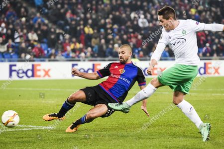 Basel's Walter Samuel (l) in Action Against Saint-etienne's Kevin Theophile-catherine During the Uefa Europa League Round of 32 Second Leg Soccer Match Between Switzerland's Fc Basel 1893 and Frances As Saint-etienne at the St Jakob-park Stadium in Basel Switzerland 25 February 2016 Switzerland Schweiz Suisse Basel