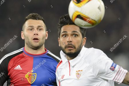 Stock Photo of Basel's Renato Steffen (l) Fights For the Ball Against Sevilla's Benoit Tremoulinas During the Uefa Europa League Round of 16 First Leg Soccer Match Between Switzerland's Fc Basel 1893 and Spain's Sevilla Futbol Club at the St Jakob-park Stadium in Basel Switzerland 10 March 2016 Switzerland Schweiz Suisse Basel