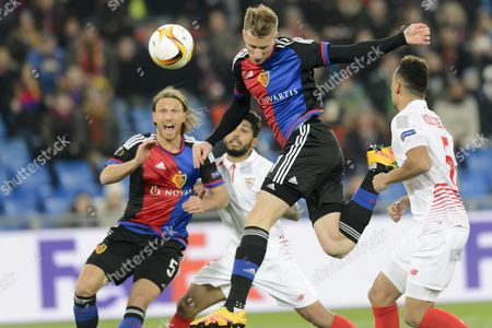 (l-r) Basel's Michael Lang Sevilla's Benoit Tremoulinas Basel's Marc Janko and Sevilla's Timothee Kolodziejczak Fight For the Ball During the Uefa Europa League Round of 16 First Leg Soccer Match Between Switzerland's Fc Basel 1893 and Spain's Sevilla Futbol Club at the St Jakob-park Stadium in Basel Switzerland 10 March 2016 Switzerland Schweiz Suisse Basel