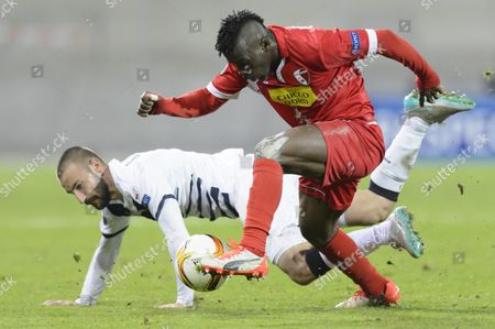 Bordeaux's Diego Contento Left Vies For the Ball with Sion's Ebenezer Assifuah Right During the Uefa Europa League Group B Soccer Match Between Fc Sion and Fc Girondins Bordeaux at the Tourbillon Stadium in Sion Switzerland 05 November 2015 Switzerland Schweiz Suisse Sion