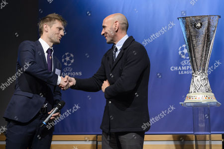 Fiorentina's Former Soccer Player Martin Jorgensen (l) Shakes Hands with Sevilla's General Sports Manager Ramon Rodriguez Verdejo During the Draw of the Semi-finals of Uefa Europa League 2014/15 at the Uefa Headquarters in Nyon Switzerland 24 April 2015 Switzerland Schweiz Suisse Nyon