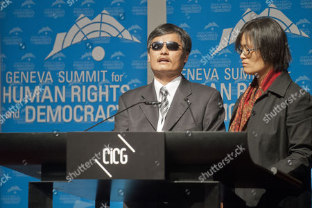 Chen Guangcheng (l) the Blind Chinese Activist with His Wife Yuan Weijing Speaks During a Geneva Summit For Human Rights and Democracy at the Geneva International Conference Center in Geneva Switzerland 25 February 2014 Switzerland Schweiz Suisse Geneve