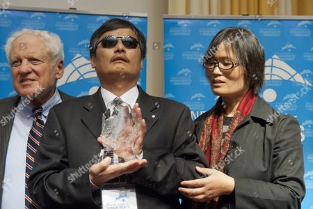 Chen Guangcheng (c) the Blind Chinese Activist with His Wife Yuan Weijing (r) and Un Watch Chair Ambassador Alfred Moses During a Geneva Summit For Human Rights and Democracy at the Geneva International Conference Center in Geneva Switzerland 25 February 2014 Switzerland Schweiz Suisse Geneve