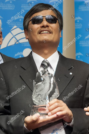 Chen Guangcheng the Blind Chinese Activist Receives the 2014 Geneva Summit Courage Award During the Geneva Summit For Human Rights and Democracy at the Geneva International Conference Center in Geneva Switzerland 25 February 2014 Switzerland Schweiz Suisse Geneve