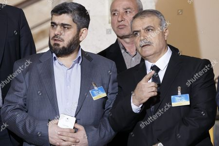 Mohammed Alloush (l) Chief Negotiator For the Main Syrian Opposition Body and Rebel Group Army of Islam and Asaad Al-zoubi (r) Head of the Syrian Opposition Delegation Listen During a Media Briefing After a New Round of Negotiations Between the Syrian Opposition and the Un Special Envoy of the Secretary-general For Syria Staffan De Mistura (no Pictured) at the European Headquarters of the United Nations in Geneva Switzerland 15 March 2016 the Civil War in Syria Has Claimed the Lives of More Than 273 000 People in Five Years Reported the Syrian Observatory For Human Rights Switzerland Schweiz Suisse Geneva