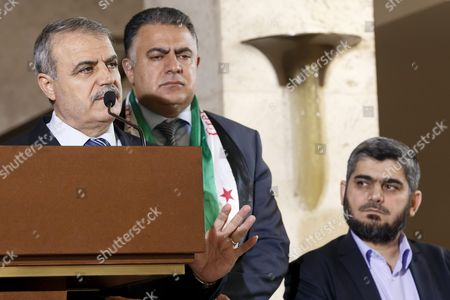 Asaad Al-zoubi (l) Head of Delegation of the High Negotiations Committee (hnc) Next to Khaled Al-mahamid (c) Member of Hnc and Mohammed Alloush (r) Chief Negotiator For the Main Syrian Opposition Body and Rebel Group Army of Islam Speaks to the Media After a Round of Negotiations Between the Syrian Opposition and Un Special Envoy of the Secretary-general For Syria Staffan De Mistura (no Pictured) at the European Headquarters of the United Nations in Geneva Switzerland 18 March 2016 Switzerland Schweiz Suisse Geneva Geneve Genf