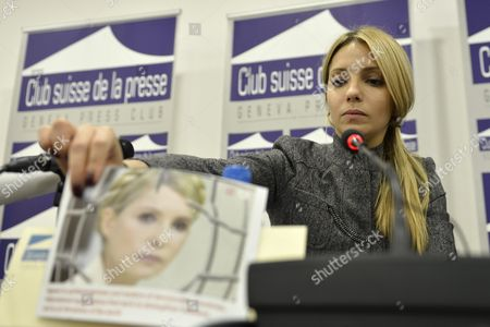 Yevgenia Tymoshenko Daughter of Jailed Former Ukrainian Prime Minister Yulia Tymoshenko Holds a Portrait of Her Mother at the Start of a Media Conference at the Geneva Press Club in Geneva Switzerland 24 October 2012 Ukrainians Vote on 28 October in Parliamentary Elections Overshadowed by the Absence of Jailed Opposition Leader Yulia Tymoshenko and Marked by Eu Worries Over the Fate of Democracy in the Ex-soviet State Switzerland Schweiz Suisse Geneva