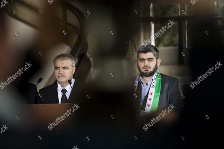 Asaad Al-zoubi (l) Head of the Syrian Opposition Delegation of High Negotiations Committee (hnc) and Mohammed Alloush Chief Negotiator For the Main Syrian Opposition Body Rebel Group Army of Islam and Member of High Negotiations Committee (hnc) Speak to the Media During a Press Conference After a Round of Negotiations Between the Syrian Opposition and the Un Special Envoy of the Secretary-general For Syria Staffan De Mistura (not Pictured) at the European Headquarters of the United Nations in Geneva Switzerland 22 March 2016 Switzerland Schweiz Suisse Geneva