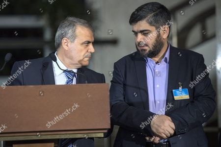 Asaad Al-zoubi (l) Head of the Syrian Opposition Delegation of High Negotiations Committee (hnc) and Mohamed Alloush (r) of the Jaysh Al Islam and Member of the Delegation of the High Negotiations Committee (hnc) Speak to the Media After a New Round of Negotiations Between the Syrian Opposition and Un Special Envoy of the Secretary-general For Syria Staffan De Mistura (not Pictured) at the European Headquarters of the United Nations in Geneva Switzerland 13 April 2016 Switzerland Schweiz Suisse Geneva
