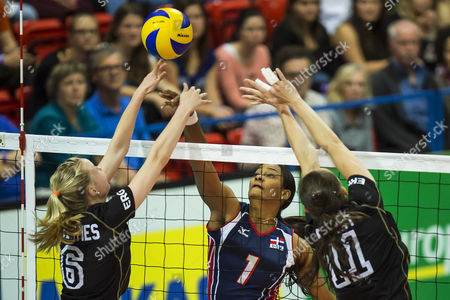 German Players Jennifer Geerties (l) and Christiane Fuerst (r) in Action Against Dominican Republic's Annerys Victoria Vargas Valdez (c) During Their Women's Montreux Volleyball Masters Game Between Germany and the Dominican Republic in Montreux Switzerland 28 May 2014 Switzerland Schweiz Suisse Montreux