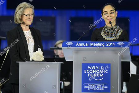 Iranian Artist Shirin Neshat (r) Speaks As She Receives a Crystal Award From Hilde Schwab Chairperson and Co-founder of the Schwab Foundation For Social Entrepreneurship (l) During the Crystal Award Ceremony on the Eve of the Opening of the 44th Annual Meeting of the World Economic Forum (wef) in Davos Switzerland 21 January 2014 the Overarching Theme of the Meeting Which Will Take Place From 22 to 25 January is 'The Reshaping of the World: Consequences For Society Politics and Business' Switzerland Schweiz Suisse Davos