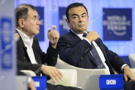 Stock Photo of Nouriel Roubini (l) Professor of Economics and International Business of the Leonard N Stern School of Business and Carlos Ghosn (r) Chairman and Chief Executive Officer Renault-nissan Alliance L Attend a Panel Session on the Third Day of the 44th Annual Meeting of the World Economic Forum (wef) in Davos Switzerland 24 January 2014 the Overarching Theme of the Meeting Which Take Place From 22 to 25 January is 'The Reshaping of the World: Consequences For Society Politics and Business' Switzerland Schweiz Suisse Davos