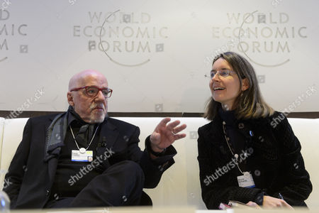 Stock Image of Swiss Author Nicole Schwab (r) Speaks with Brazilian Author Paulo Coelho (l) During a Panel Session of the 45th Annual Meeting of the World Economic Forum (wef) in Davos Switzerland 22 January 2015 the Overarching Theme of the Meeting Which Takes Place From 21 to 24 January is 'The New Global Context' Switzerland Schweiz Suisse Davos