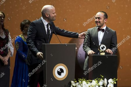 Spanish Film Director Diego Quemada-diez (r) Receives the Golden Icon Main Award From German-swiss Filmmaker and Screenwriter Marc Forster (l) For His Movie 'La Jaula De Oro' (the Golden Cage) During the Zurich Film Festival in Zurich Switzerland 05 October 2013 Switzerland Schweiz Suisse Zurich