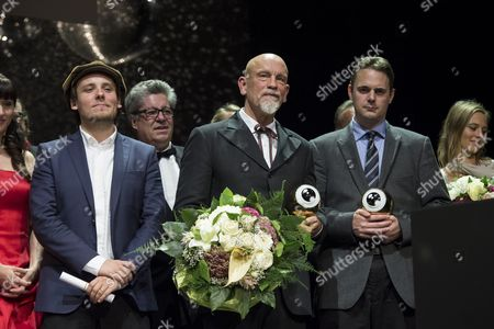 Us Actor Director and Producer John Malkovich (c) and British Film Director Nick Broomfield (2-r) Pose on Stage with Their Awards During the Award Night of the 10th Zurich Film Festival in Zurich Switzerland 04 October 2014 the Zurich Film Festival (zff) Runs Until 05 October Switzerland Schweiz Suisse Zurich