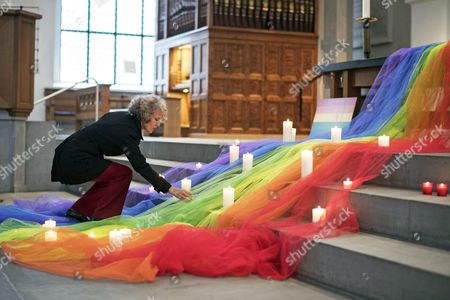 Zurich Mayor Corine Mauch Places a Candle During a Vigil For the Victims of a Mass Shooting in Orlando Usa on 12 June at a Church in Zurich Switzerland 13 June 2016 a Total of 50 People Inculding the Suspect Were Killed and 53 Were Injured in a Shooting Attack at an Lgbt Club in Orlando Florida in the Early Hours of 12 June the Shooter Omar Mateen 29 a Us Citizen of Afghan Descent was Killed in an Exchange of Fire with the Police After Taking Hostages at the Club Epa/ennio Leanza Switzerland Schweiz Suisse Zurich