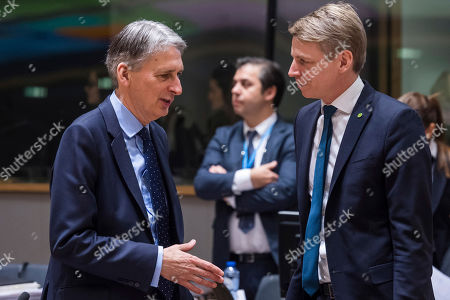 Philip Hammond, Per Bolund Britain's Chancellor of the Exchequer Philip Hammond, left, talks with Sweden's Financial Markets Minister Per Bolund during a round table meeting of EU finance ministers at the EU Council building in Brussels