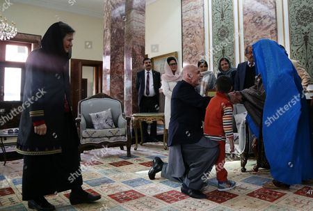 Afghan President Ashraf Ghani (c) and Afghan First Lady Rula Ghani (l) Receive Afghan Woman Sharbat Gula (r) After She Arrived From Pakistan in Kabul Afghanistan 09 November 2016 Pakistani Anti-corruption and Immigration Court Sentenced on 04 November 15 Days Jail and 110000 Pak Rupees (1000 Us Dollar) Fine to Sharbat Gula Before Being Deported to Afghanistan Gula Has Been Detained For Allegedly Possessing a Fake Identity Card She was Arrested on 26 October For Allegedly Obtaining Pakistani Identity Documents For Herself and Her Two Children After Bribing Three Officials Charges That Could Land Her a 14-year Jail Sentence Sharbat Gula Became Famous by the Photographic Portrait 'Afghan Girl' Taken of Her with Her Striking Green Eyes by Photographer Steve Mccurry and Published on the Cover of the 'National Geographic' in June 1985 Afghanistan Kabul