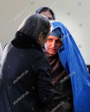 Afghan First Lady Rula Ghani (l) Stands with the Family of Afghan Woman Sharbat Gula (r) After She Arrived From Pakistan in Kabul Afghanistan 09 November 2016 Pakistani Anti-corruption and Immigration Court Sentenced on 04 November 15 Days Jail and 110000 Pak Rupees (1000 Us Dollar) Fine to Sharbat Gula Before Being Deported to Afghanistan Gula Has Been Detained For Allegedly Possessing a Fake Identity Card She was Arrested on 26 October For Allegedly Obtaining Pakistani Identity Documents For Herself and Her Two Children After Bribing Three Officials Charges That Could Land Her a 14-year Jail Sentence Sharbat Gula Became Famous by the Photographic Portrait 'Afghan Girl' Taken of Her with Her Striking Green Eyes by Photographer Steve Mccurry and Published on the Cover of the 'National Geographic' in June 1985 Afghanistan Kabul