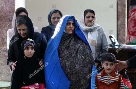 Afghan First Lady Rula Ghani (l) Stands with the Family of Afghan Woman Sharbat Gula (c) After She Arrived From Pakistan in Kabul Afghanistan 09 November 2016 Pakistani Anti-corruption and Immigration Court Sentenced on 04 November 15 Days Jail and 110000 Pak Rupees (1000 Us Dollar) Fine to Sharbat Gula Before Being Deported to Afghanistan Gula Has Been Detained For Allegedly Possessing a Fake Identity Card She was Arrested on 26 October For Allegedly Obtaining Pakistani Identity Documents For Herself and Her Two Children After Bribing Three Officials Charges That Could Land Her a 14-year Jail Sentence Sharbat Gula Became Famous by the Photographic Portrait 'Afghan Girl' Taken of Her with Her Striking Green Eyes by Photographer Steve Mccurry and Published on the Cover of the 'National Geographic' in June 1985 Afghanistan Kabul