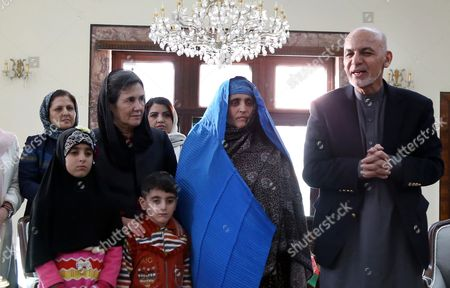 Afghan President Ashraf Ghani (r) and Afghan First Lady Rula Ghani (l) Receive Afghan Woman Sharbat Gula (c) After She Arrived From Pakistan in Kabul Afghanistan 09 November 2016 Pakistani Anti-corruption and Immigration Court Sentenced on 04 November 15 Days Jail and 110000 Pak Rupees (1000 Us Dollar) Fine to Sharbat Gula Before Being Deported to Afghanistan Gula Has Been Detained For Allegedly Possessing a Fake Identity Card She was Arrested on 26 October For Allegedly Obtaining Pakistani Identity Documents For Herself and Her Two Children After Bribing Three Officials Charges That Could Land Her a 14-year Jail Sentence Sharbat Gula Became Famous by the Photographic Portrait 'Afghan Girl' Taken of Her with Her Striking Green Eyes by Photographer Steve Mccurry and Published on the Cover of the 'National Geographic' in June 1985 Afghanistan Kabul
