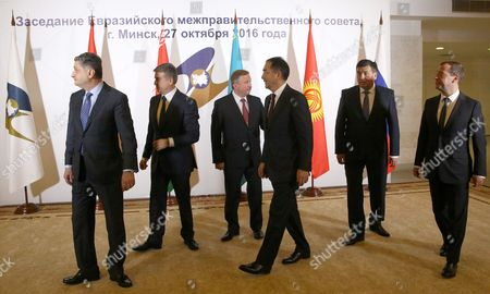 (l-r) Chairman of the Eurasian Economic Commission Board Tigran Sargsyan Armenian Prime Minister Karen Karapetyan Belarusian Prime Minister Andrei Kobyakov Kazakhstan's Prime Minister Bakhytzhan Sagintayev Kyrgyzstan's Prime Minister Sooronbay Jeenbekov and Russian Prime Minister Dmitry Medvedev Leave After Posing For a Picture During the Eurasian Intergovernmental Council Meeting at the Palace of Republic in Minsk Belarus 27 October 2016 Belarus Minsk