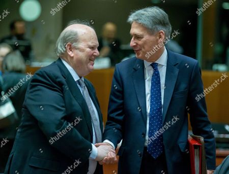 Irish Finance Minister Michael Noonan and Uk Finance Minister Philip Hammond (r) During a European Finance Ministers Meeting in Brussels Belgium 06 December 2016 Belgium Brussels