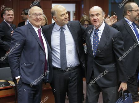 (l-r) European Commissioner in Charge of French Finance Minister Michel Sapin Economic and Financial Affairs Pierre Moscovici and Greek Finance Minister Euclidis Tsakalotos Spanish Minister of Economy Luis De Guindos During Eurogroup Finance Ministers Meeting in Brussels Belgium 05 December 2016 Eurogroup Discuss Member States' Draft Budgetary Plans For 2017 and Will Be Briefed by the Institutions on the State of Play of the Greek Second Review of the Economic Adjustment Programme Belgium Brussels