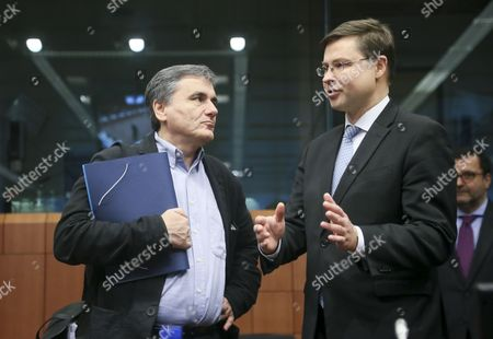 Stock Image of Valdis Dombrovskis (r) European Commission Vice-president in Charge of the Euro and Social Dialogue and Greek Finance Minister Euclidis Tsakalotos (l) During Eurogroup Finance Ministers Meeting in Brussels Belgium 05 December 2016 Eurogroup Discuss Member States' Draft Budgetary Plans For 2017 and Will Be Briefed by the Institutions on the State of Play of the Greek Second Review of the Economic Adjustment Programme Belgium Brussels
