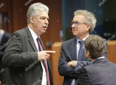 Austrian Finance Minister Hans Joerg Schelling (l) and Luxembourg Finance Minister Pierre Gramegna (r) During the Eurogroup Finance Ministers Meeting in Brussels Belgium 05 December 2016 Eurogroup Discuss Member States' Draft Budgetary Plans For 2017 and Will Be Briefed by the Institutions on the State of Play of the Greek Second Review of the Economic Adjustment Programme Belgium Brussels