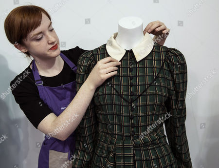 An Auction Worker Prepares Princess Diana's Tartan Wool Dress For Display at Kerry Taylor Auctions Before the 'Passion For Fashion' Auction in London Britain 07 December 2016 Three Dresses Worn by the Late Princess Diana a Cotton Dress Worn by Princess Margaret Along with a Feather Hat and Muff Worn by Audrey Hepburn Are Scheduled to Be Auctioned Off 12 December United Kingdom London