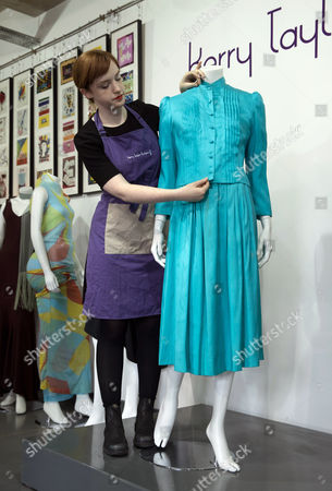 An Assistant Prepares Princess Diana's Turquoise Silk Ensemble For Display at Kerry Taylor Auctions Before the 'Passion For Fashion' Auction in London Britain 07 December 2016 Three Dresses Worn by the Late Princess Diana a Cotton Dress Worn by Princess Margaret Along with a Feather Hat and Muff Worn by Audrey Hepburn Are Scheduled to Be Auctioned Off 12 December United Kingdom London