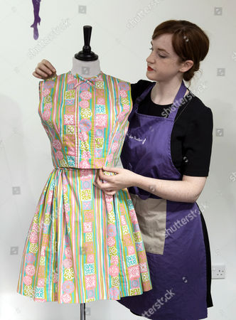 An Assistant Prepares Princess Margaret's Cotton Dress For Display at Kerry Taylor Auctions Before the 'Passion For Fashion' Auction in London Britain 07 December 2016 Three Dresses Worn by the Late Princess Diana a Cotton Dress Worn by Princess Margaret Along with a Feather Hat and Muff Worn by Audrey Hepburn Are Scheduled to Be Auctioned Off 12 December Epa/hayoung Jeon United Kingdom London