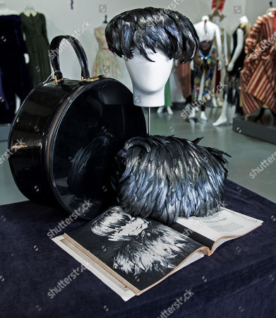 The Late British Actress Audrey Hepburn's Black Feather Hat and Muff Along with Their Case and Magazine on Display at Kerry Taylor Auctions Before the 'Passion For Fashion' Auction in London Britain 07 December 2016 Three Dresses Worn by the Late Princess Diana a Cotton Dress Worn by Princess Margaret Along with a Feather Hat and Muff Worn by Audrey Hepburn Are Scheduled to Be Auctioned Off 12 December United Kingdom London