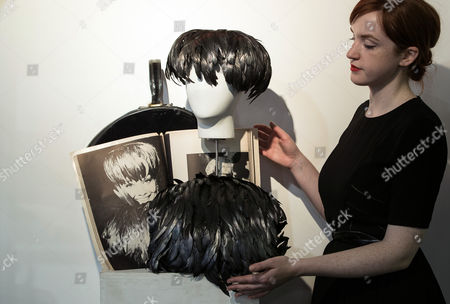 An Assistant Prepares the Late British Actress Audrey Hepburn's Black Feather Hat and Muff Along with Their Case and Magazine at Kerry Taylor Auctions Before the 'Passion For Fashion' Auction in London Britain 07 December 2016 Three Dresses Worn by the Late Princess Diana a Cotton Dress Worn by Princess Margaret Along with a Feather Hat and Muff Worn by Audrey Hepburn Are Scheduled to Be Auctioned Off 12 December United Kingdom London