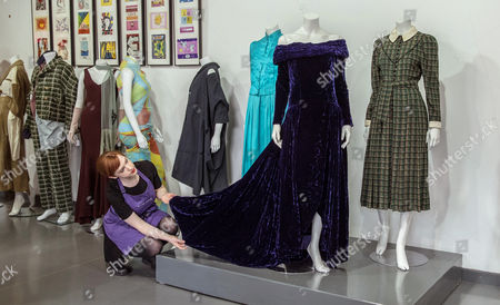 An Auction Worker Prepares Princess Diana's Purple Velvet Evening Gown For Display at Kerry Taylor Auctions Before the 'Passion For Fashion' Auction in London Britain 07 December 2016 Three Dresses Worn by the Late Princess Diana a Cotton Dress Worn by Princess Margaret Along with a Feather Hat and Muff Worn by Audrey Hepburn Are Scheduled to Be Auctioned Off 12 December United Kingdom London